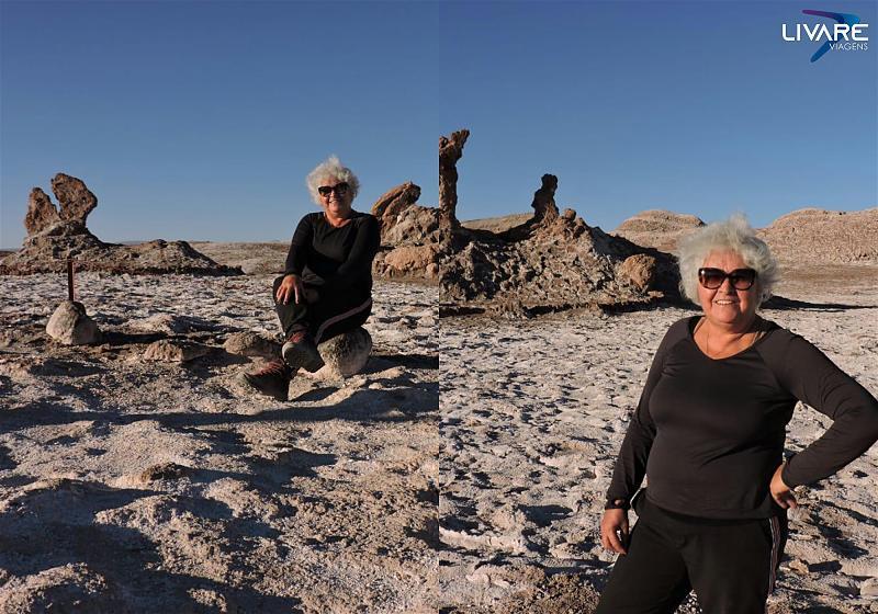 senhora em frente ao monumento três marias no deserto do atacama